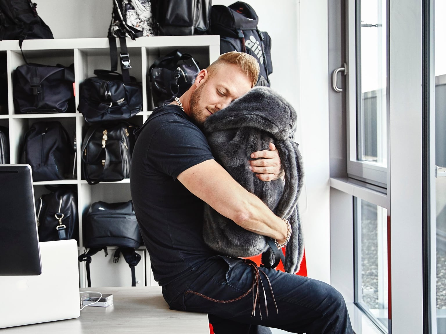 PUMA Creative Director Stuart Adams hugging a bag