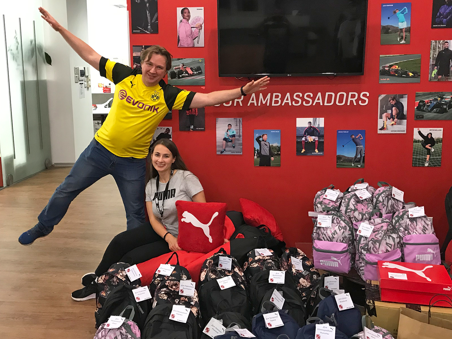 PUMA employees with backpacks for kids