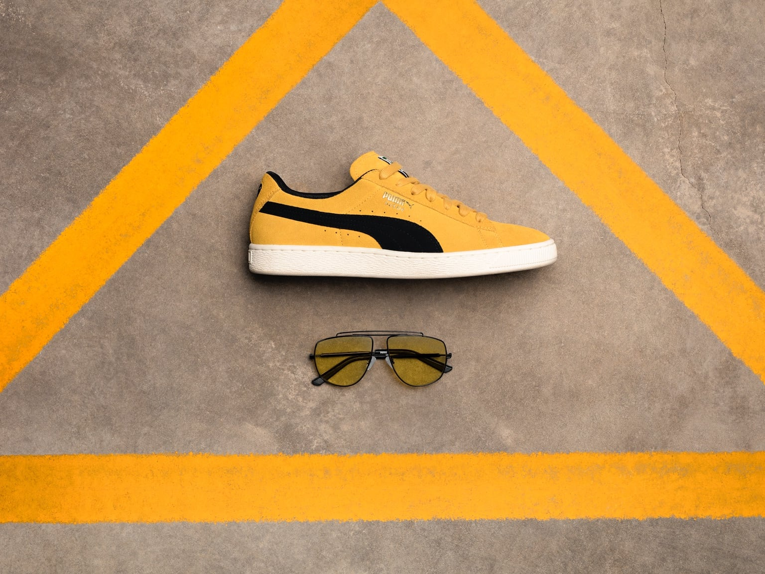 Kering Eyewear and PUMA Suede shoe