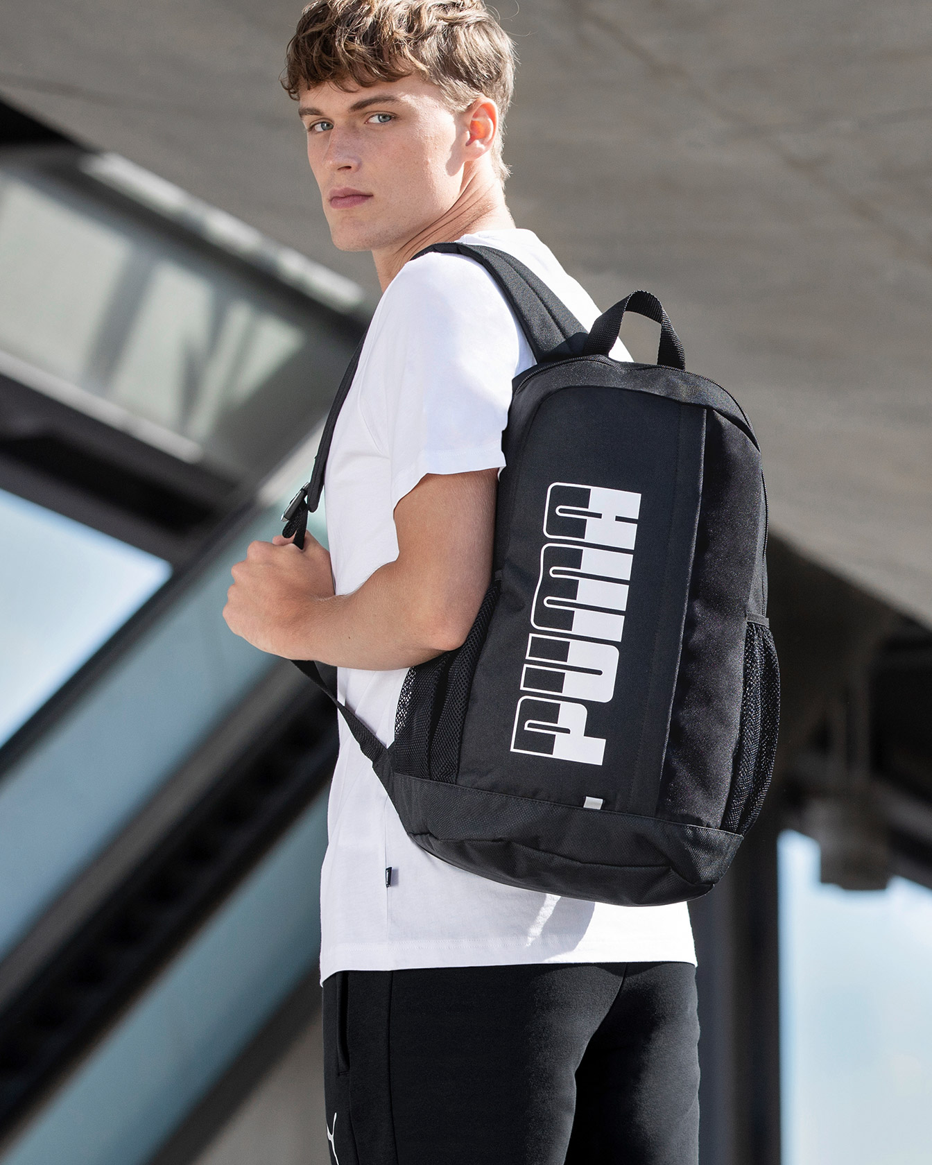 Model with PUMA Backpack
